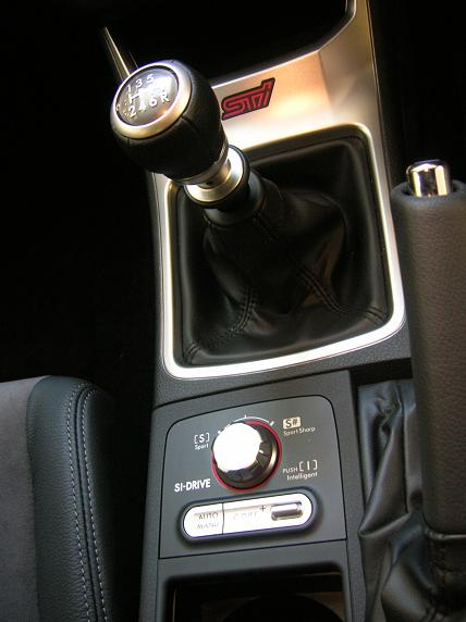 Six-speed shifter feels rubbery in showroom conditions. SI-Drive controller allows driver to determine throttle response.