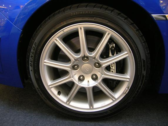 "Huge Brembos with STI-badged callipers. Dunlop SP Sport 01 tyres wrap around 17"" rims."