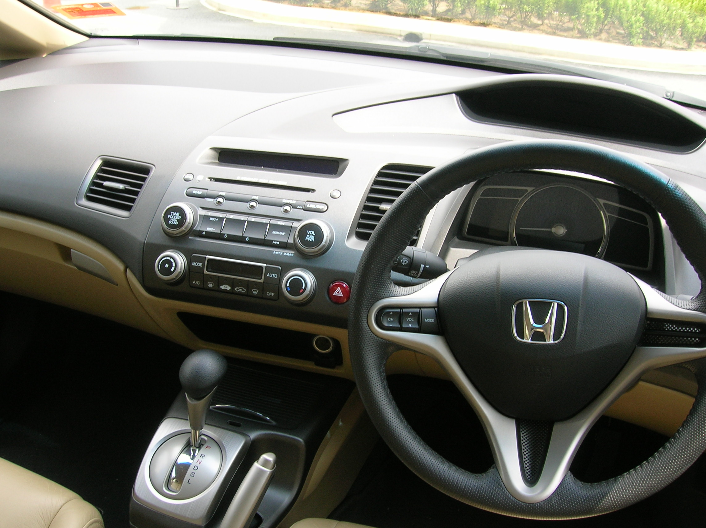 Interior's standard Honda Civic.